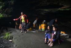 Tengger villagers take a rest after climbing Mt. Bromo. JP/Aman Rochman