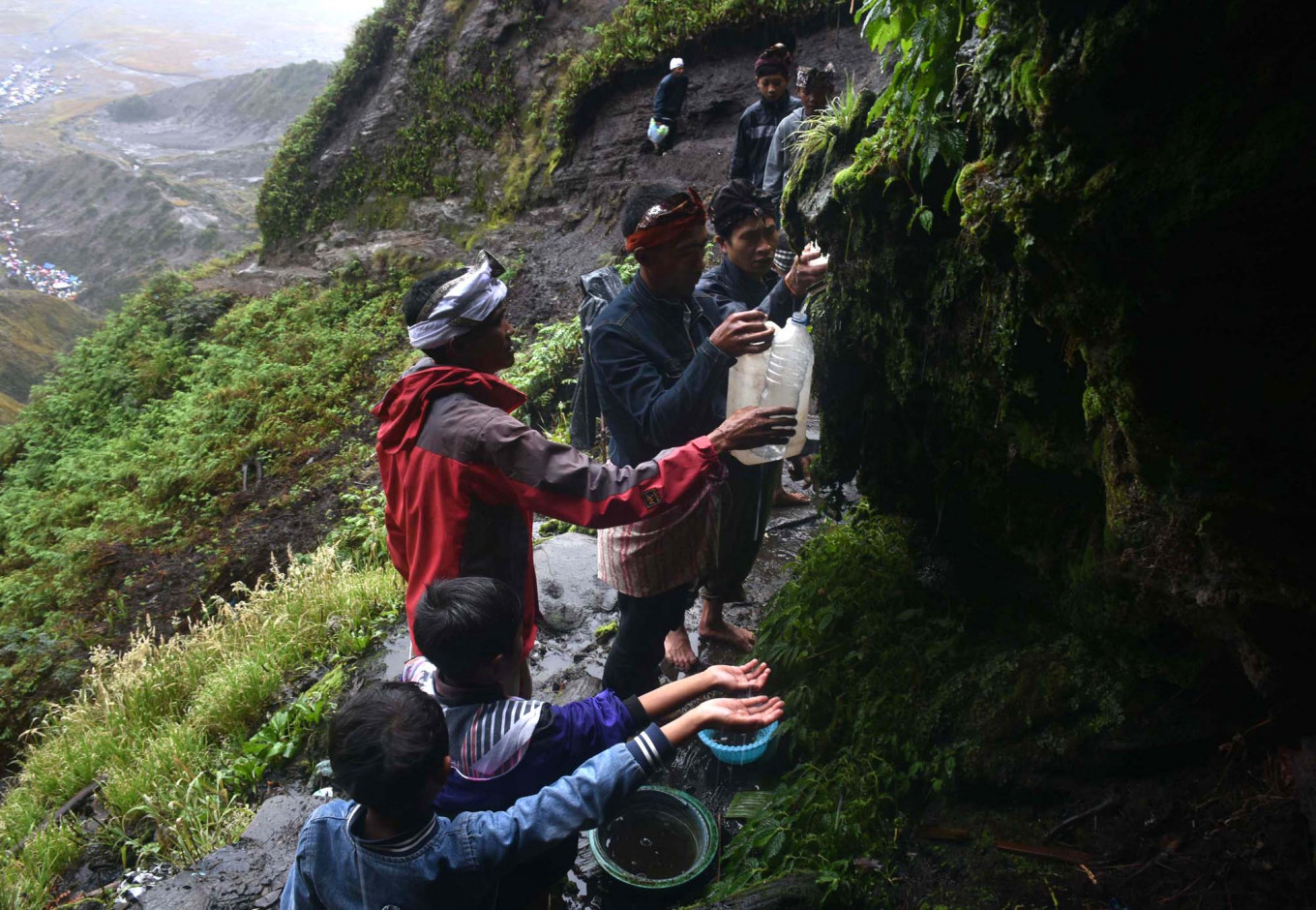 Tengger people collect the holy water from the spring. JP/Aman Rochman