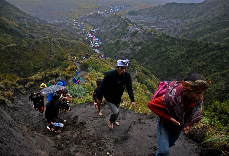 Celebrants climb Mt. Bromo to reach the Widodaren cave. JP/Aman Rochman
