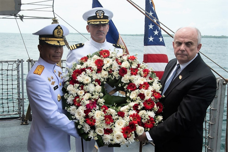 In remembrance: US Ambassador to Indonesia Joseph Donovan Jr. (right), Naval Attaché of US Embassy Jakarta Cmdr. Greg Adams (center) and Indonesian Navy Adm. Denih Hendrata, Commander Main Naval Base III, Jakarta, prepare to lay a wreath during a memorial service aboard the Indonesian Navy ship KRI Usman Harun. The ceremony was held to honor the American and Australian crews of USS Houston and HMAS Perth that lost their lives in the Battle of the Sunda Strait.