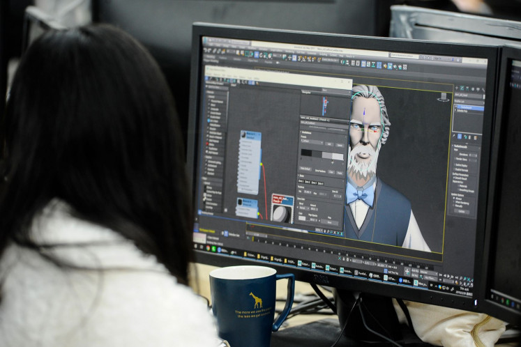Final touch: A staff member works on the online cartoon series