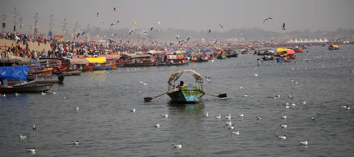 Flock to the river: Migratory birds from Siberia are seen in the Ganges alongside boats during the Kumbh Mela. JP/PJ Leo
