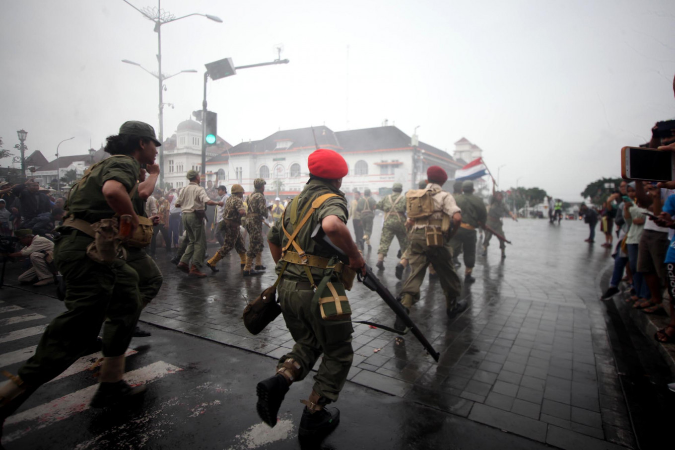 Dutch military reenactors attack mock Indonesian independence fighters during the performance. JP/Boy T. Harjanto