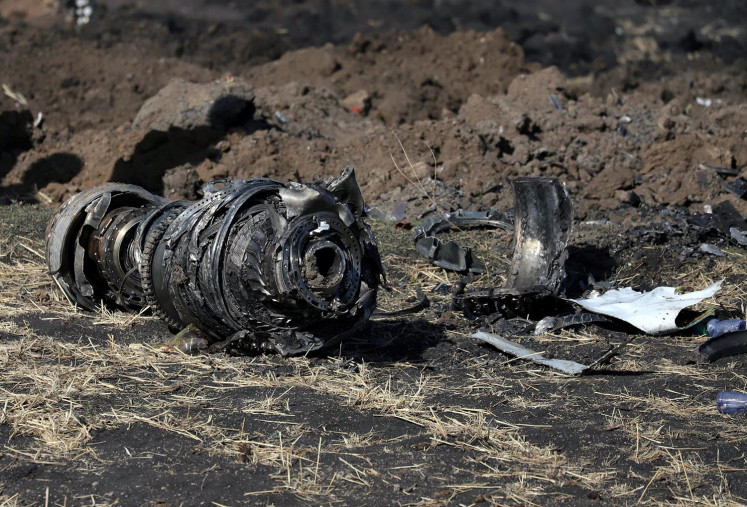 Engine parts are seen at the scene of the Ethiopian Airlines flight ET 302 plane crash, near the town of Bishoftu, southeast of Addis Ababa, Ethiopia March 11, 2019.