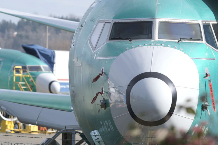 Unworthy: A Boeing 737 MAX 8 is pictured outside the manufacturer's factory in Renton, Washington, the United States, on Monday. Boeing's stock dropped after an Ethiopian Airlines flight was the second deadly crash in six months involving the Boeing 737 Max 8, the newest version of its most popular jetliner.