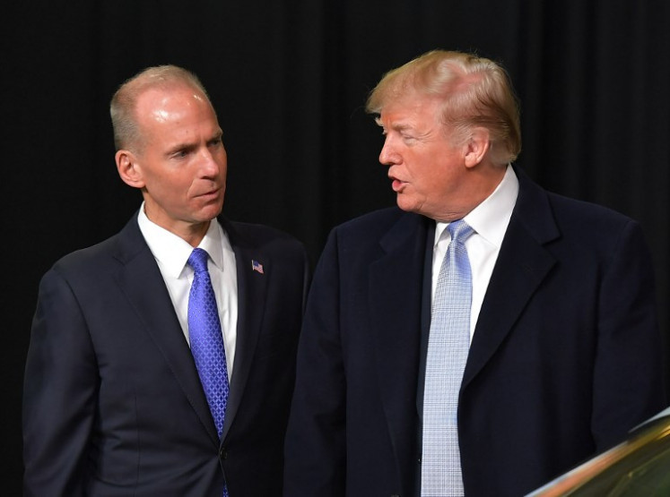 In this file photo taken on March 14, 2018, US President Donald Trump speaks with Boeing CEO Dennis Muilenburg ( 2L ) during a tour of the Boeing Company in St. Louis, Missouri. Trump spoke with Muilenburg on March 12, 2019, about the crash of a 737 MAX 8 aircraft that killed 157 people, an industry source told AFP. The telephone call took place after Trump sent a tweet earlier in the day that said: