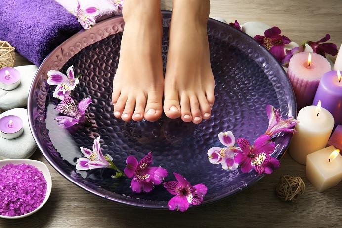 A female feet at a spa pedicure procedure.