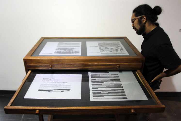 "A contemplation: A visitor observes ""Sensor"" (Censor) from Harits Rasyid Paramasatya."