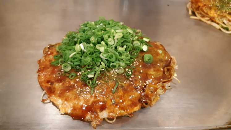 Savory treat: Unlike Osaka-style okonomiyaki, which is cooked by mixing all the ingredients, the Hiroshima-style one layers each ingredient and always includes noodles.