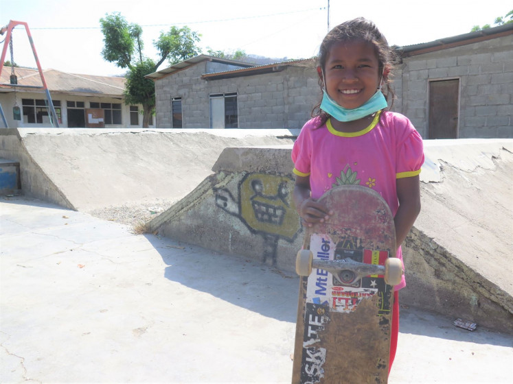 All smiles: A young skater poses at the worn-down Dili skate park.