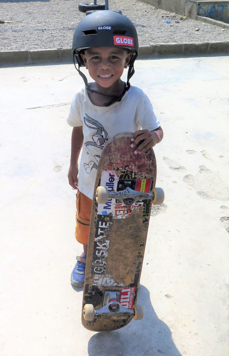 Happy: One of Timor Leste's youngest skaters poses at the park in Dili.