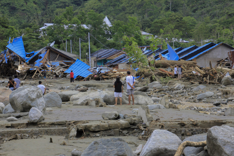 Residents examine their wrecked homes  after flooding in Sentani, Jayapura, Papua on Sunday. Some 50 people are believed to have lost their lives in the deluge.