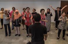 Dialita choir members warm up prior to the concert. JP/Rosa Panggabean