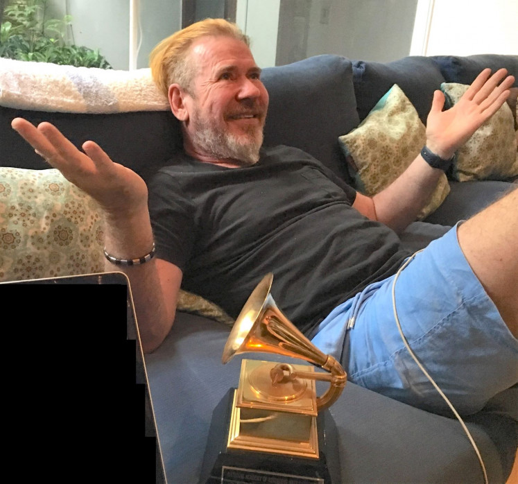 Award winning: Steve Lillywhite is seen with one of his Grammy Awards when telling his friend and writer Paul Goddard about first meeting U2.