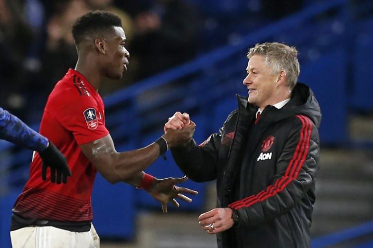 Pogba wants 'happy coach' Solskjaer to stay at Man Utd