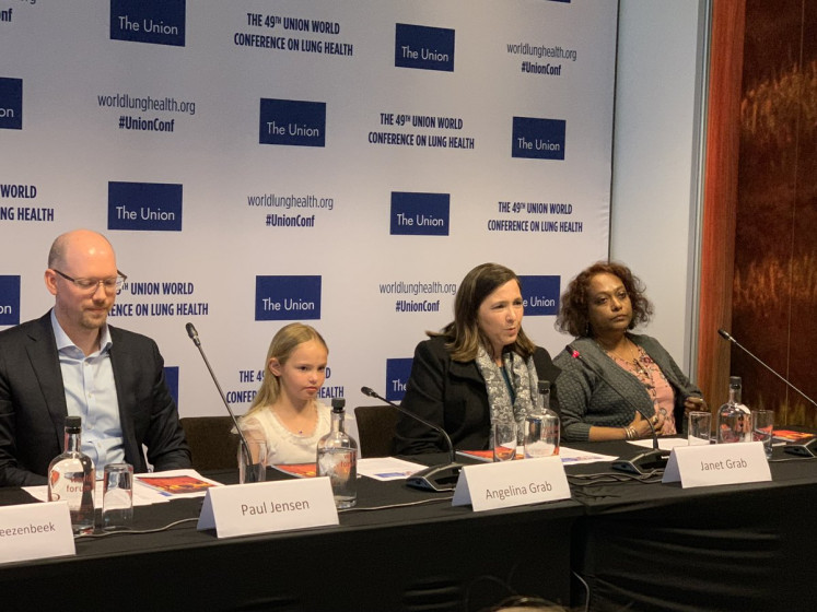 In the spotlight: Angelina Grab (second left), a 9-year-old child TB survivor from South Africa, attends a press conference during the 49th World Lung Health Conference in The Hague, the Netherlands. She is one of the 1 million children affected by child TB worldwide.