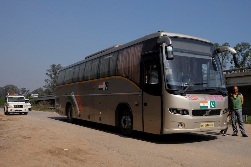 Guns and tourists: Aboard the unlikely India-Pakistan 'friendship bus'