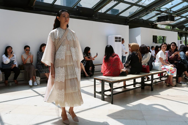 Fashion designer Sapto Djojokartiko is recognized for his choice of neutral colors.