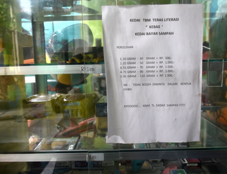 A list of prices on the library's stall where children can pay using plastic waste.