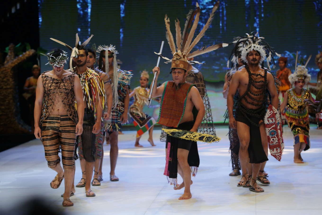Models walk down the catwalk accompanied by traditional dancers in 'Viro Dream', a fashion show and art performance resulting from a collaboration between designer Musa Widyatmodjo and Viro.