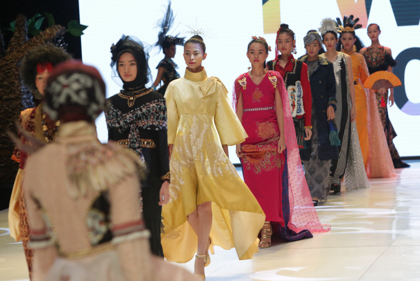 Wearing the designs of 10 emerging Indonesian designers, models strut down the catwalk during the opening ceremony of Indonesia Fashion Week 2019 on Wednesday at the Jakarta Convention Center in Central Jakarta.