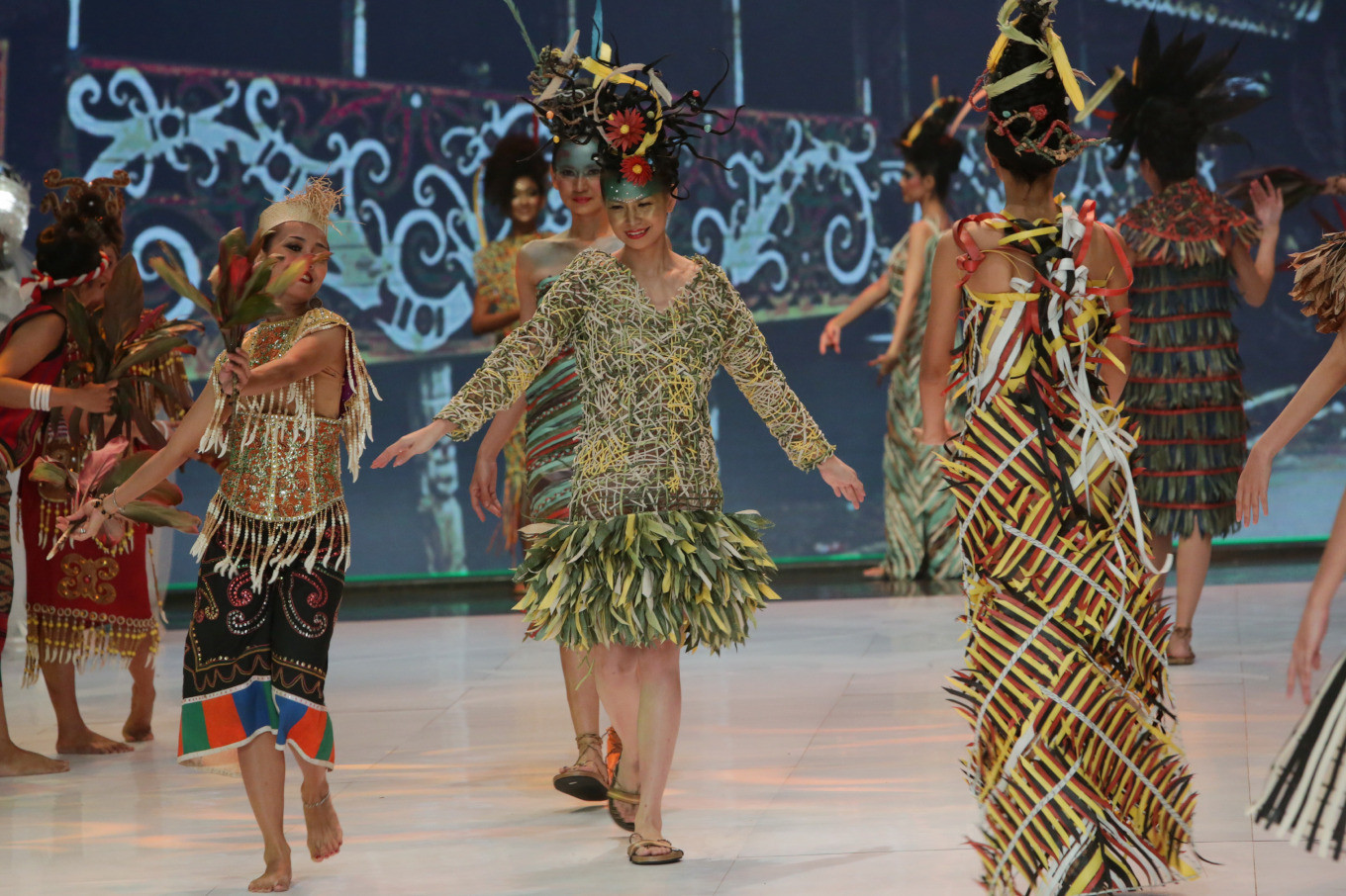 Models dance on the catwalk at Indonesia Fashion Week 2019 on Wednesday at the Jakarta Convention Center in Central Jakarta. Despite being made out of eco faux, the outfits are still comfortable for the models.