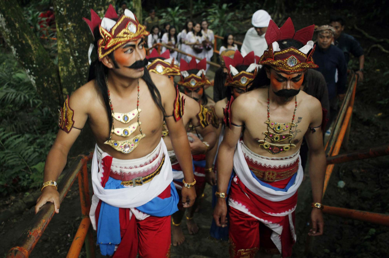 Marching on: Residents wearing traditional Javanese costumes climb Tidar Hill. JP/Magnus Hendratmo