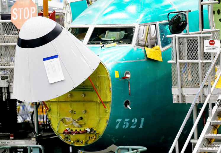 Antistall system: The angle of attack sensor, at bottom center, is seen on a 737 MAX aircraft at the Boeing factory in Renton, Washington, US, on Wednesday. Boeing says it has developed software fixes to prevent failures of the automated flight control system.