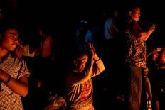 Balinese people pray to gods during the Terteran (battle of fire) ritual in March 2019 in Jasri village, in Karangasem, Bali. JP/Agung Parameswara