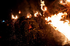 A Barong made of coconut leaves dances in a fire during the Mabuwu-Buwu ritual in March 2019 at Punduk Dawa village, in Klungkung. JP/Agung Parameswara