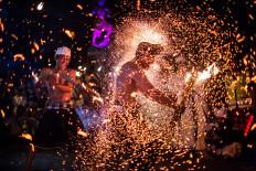 Balinese men hit each other during the Lukat Gni (battle of fire) ritual in Paksa Bali village, Klungkung. JP/Agung Parameswara