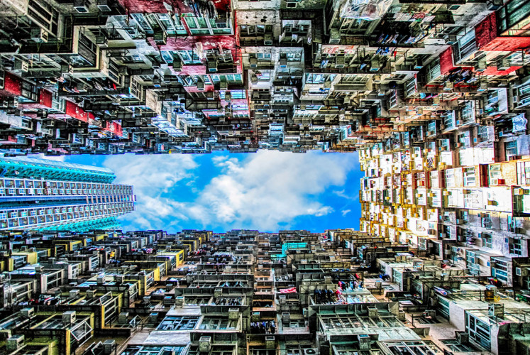 A vertical view of Montane Mansion reveals blocks of balconies that stretch to the skies above Quarry Bay, Hong Kong.