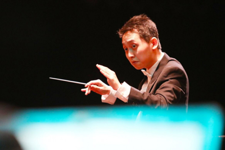 Guest conductor Kevin Atmadja wields his baton during the Jakarta City Philharmonic's