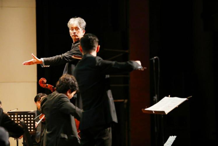 Principal conductor Budi Utomo Prabowo leads the Jakarta City Philharmonic in