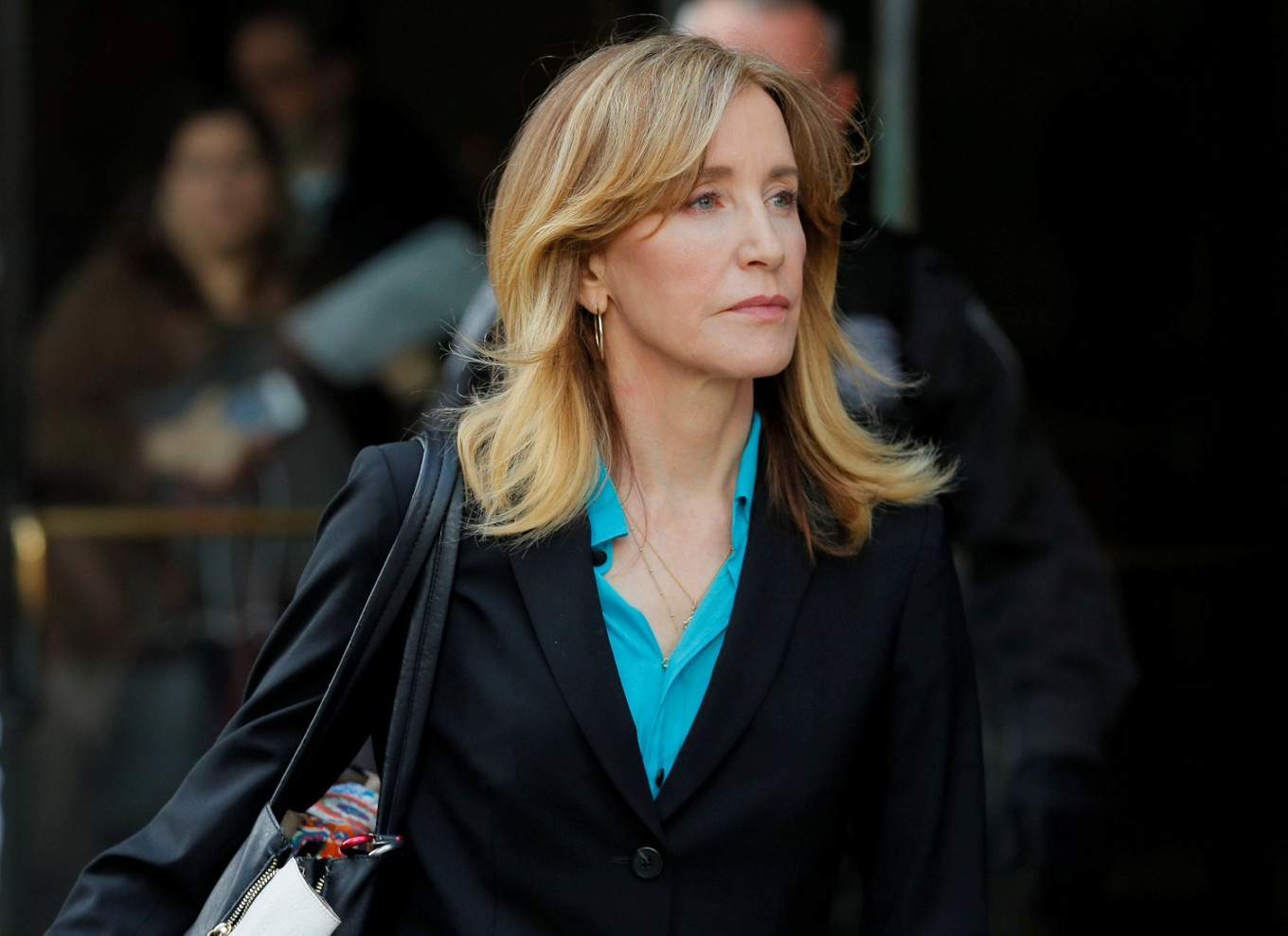Tearful Felicity Huffman admits role in US college admissions scandal