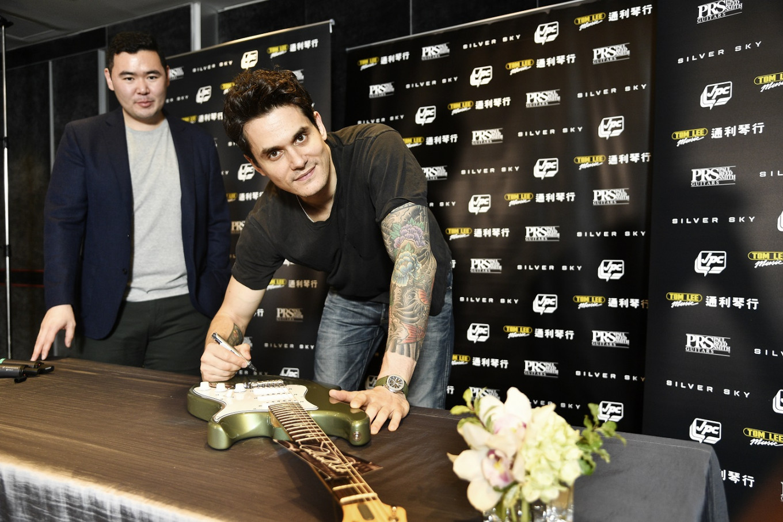 John Mayer donates four guitars for Hong Kong's youth music programs