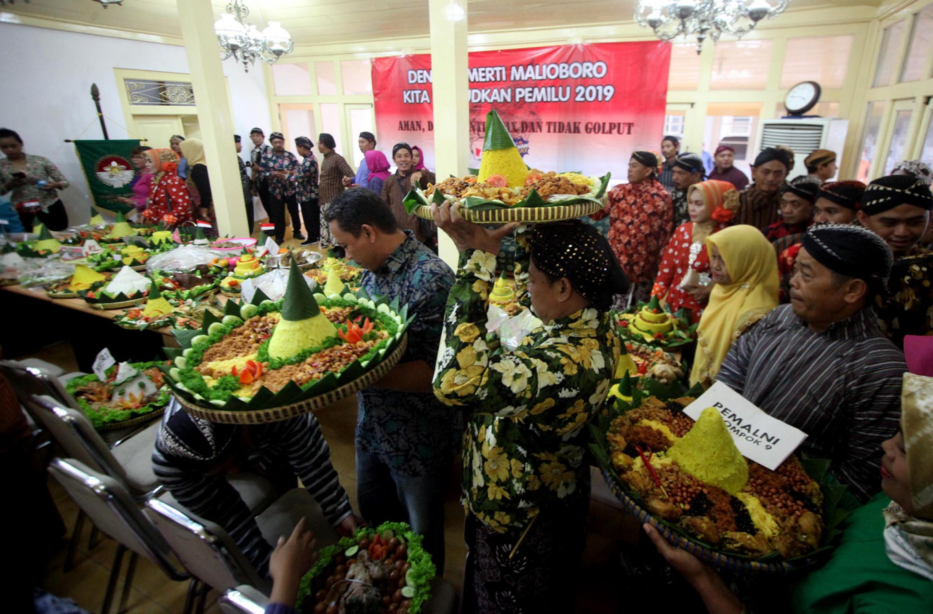Each community brings a tumpeng that will be blessed with a prayer for peace prior to the elections. JP/Boy T. Harjanto