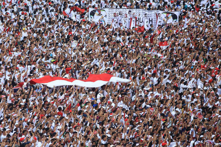 """Supporters of President Joko """"Jokowi"""" Widodo attend the incumbent's final and largest open-air campaign rally at the Gelora Bung Karno Stadium in Jakarta on Saturday."""