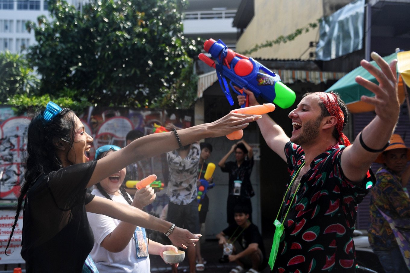 Thai new year splashes in with water fights, raves