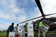 Officials carry ballot boxes for the 2019 elections at Wamena Airport in Jayawijaya, Papua, on Sunday. The boxes were distributed with helicopters to Yalimo regency in Welare and Benawa districts. Antara/Yusran Uccang