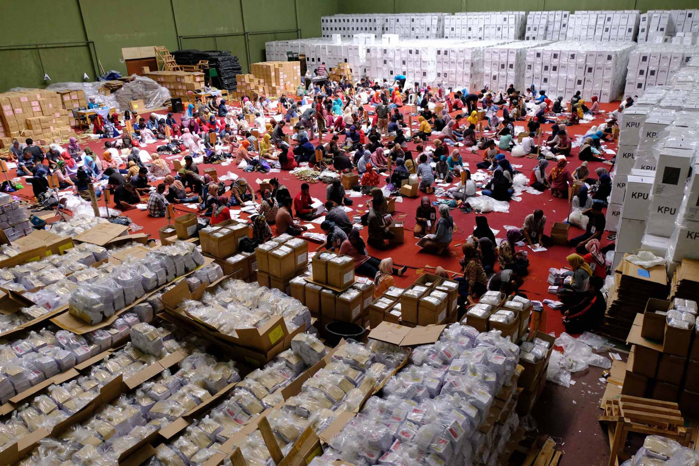 Temanggung General Elections Committee (KPUD) workers fold ballots for the 2019 elections at the Bambu Runcing sports hall in Temanggung, Central Java, on April 1. As many as 350 residents were employed to prepare the materials.