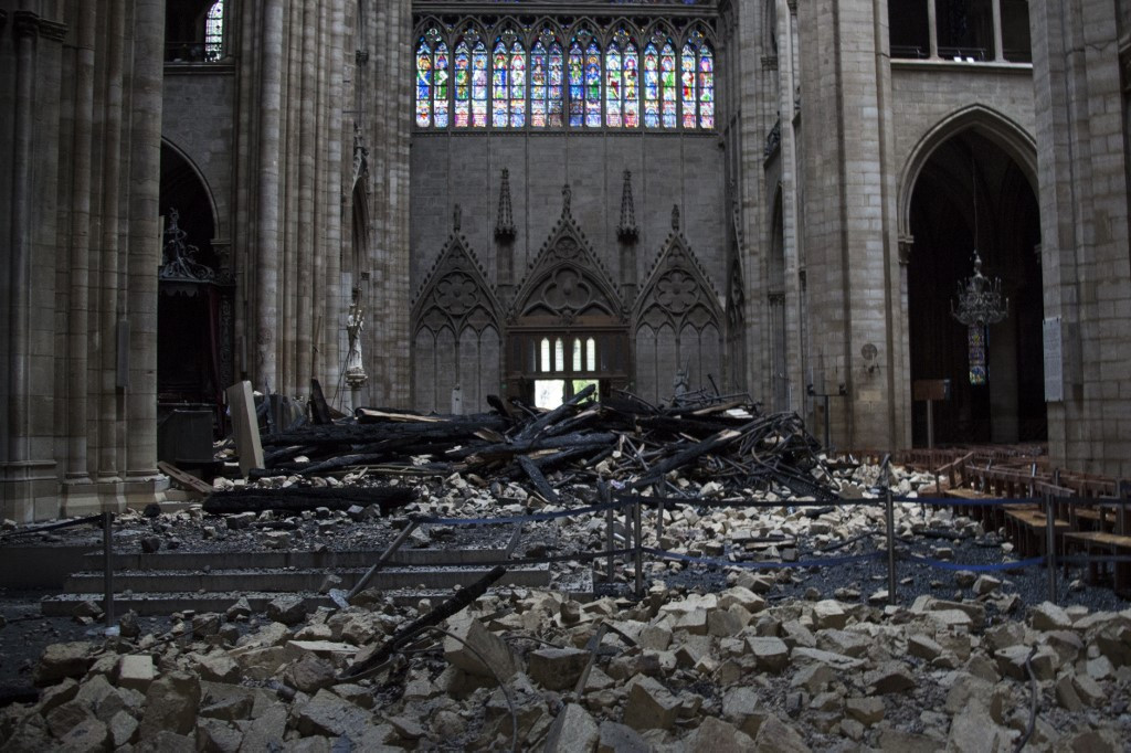 Macron vows to rebuild a 'more beautiful' Notre Dame in 5 years