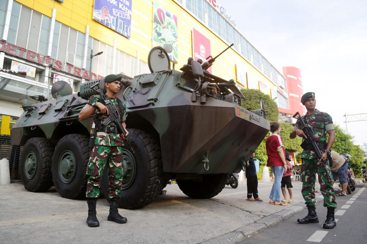 Jokowi must prove commitment to domestic defense industry