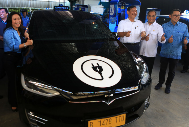 The launch of Blue Bird's e-taxis is attended by ( left to right) the company's president director Noni Purnomo, Coordinating Maritime Affairs Minister Luhut Pandjaitan, Transportation Minister Budi Karya Sumadi and Blue Bird director Andrianto Djokosoetono in Jakarta on April 22.