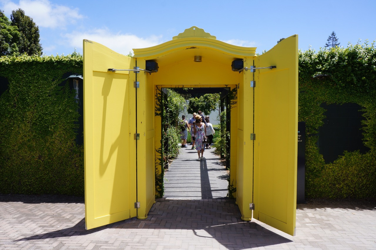This yellow cupboard is actually a gateway in the Concept Garden, part of the Fantasy Collection of Hamilton Gardens in Hamilton, New Zealand.