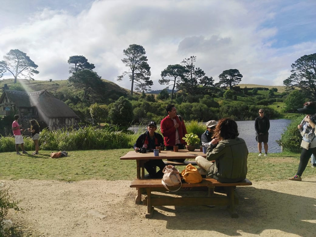 Visitors unwind at The Green Dragon Inn's picnic tables at the Hobbiton movie set in Matamata, New Zealand.