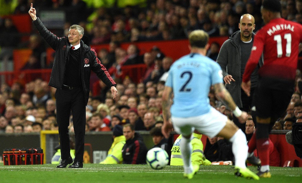 Guardiola's Man City raise the bar as Man Utd suffer more misery