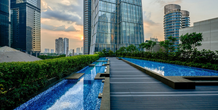 Alila SCBD's 'catwalk pool' with the hotel's main building, dubbed the 'diamond-shaped tower' in the background.