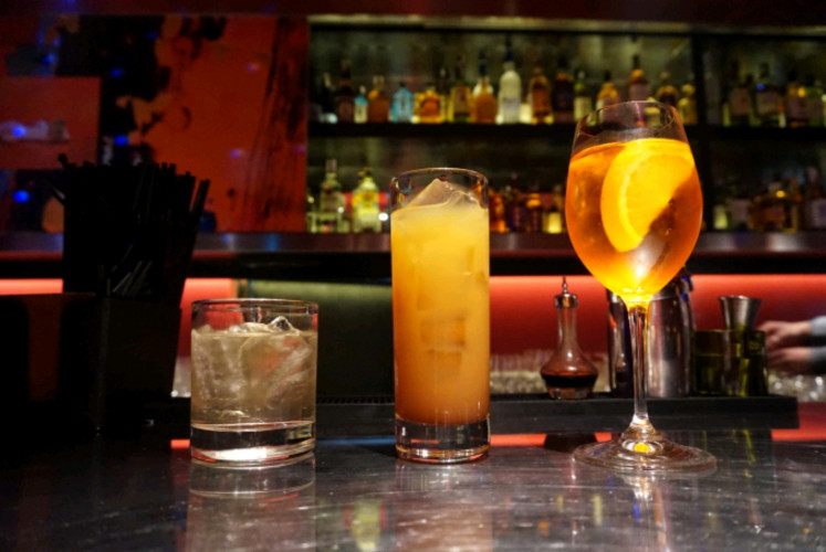 Among Zodiac's recommended beverages are (from left to right) umeshu soda, cassis orange and aperol spritz.