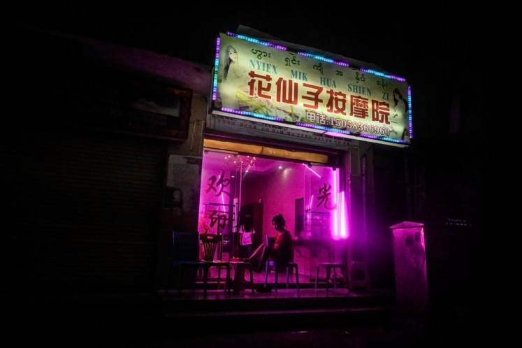 This picture taken on April 17, 2019 shows Chinese characters on a signboard of a shop offering services to cross-border individuals in Panghsang.
